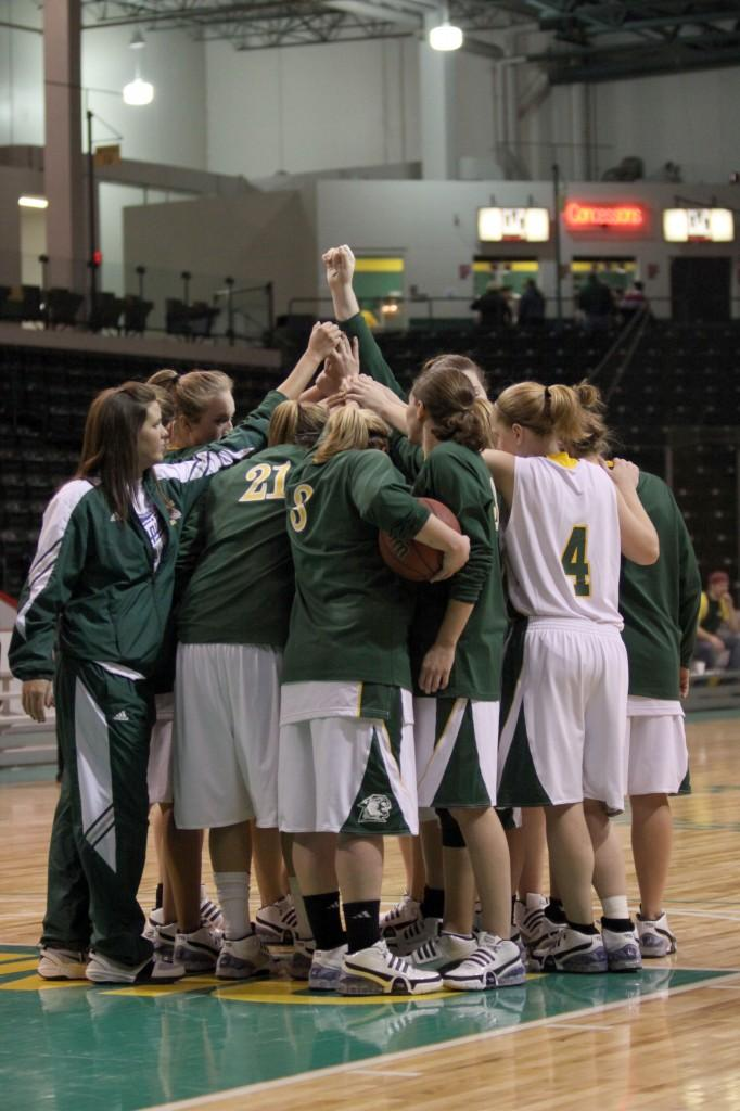 The NMU Wildcats huddle up for a cheer before one of their regular season games in the Berry Events Center this season. // Justin Key / NW