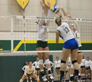 NMU goes up for the block while competing in the superior Oasis Wildcat Volleyball Open, to win the weekend tournament at the Vandament Arena (Photo: Anthony Viola)