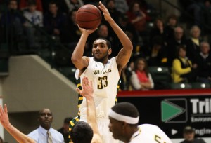 The men's basketball team returns three players from last year, losing the experience of athletes such as Kendall Jackson, and giving newly hired assistant coach Charles Belt a challenge. (NW File Photo)