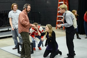 """Jean Valjean pays the Thernadiers in """"Les Mis.'"""" Left to right: Devin Murphy, Paul Truckey, Andy Lawrence, Monica Noreen and Ethan Burke. (Kristen Koehler NW)"""