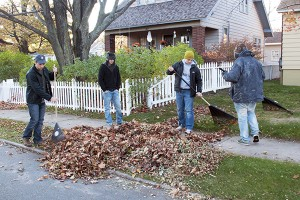 Students and organizations volunteer to rake leaves and do other yard work for the local community as part of Make a Difference Day each year. (Kristen Koehler NW)