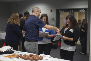 Students talk to potential employers at a 2012 job fair, one of the many Career Services-sponsored events for students seeking internship or employment opportunities. (Rebecca Tadych/Communications Dept.)