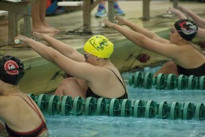 NMU sophomore Sam Clemence, center, earned her first letter last season after competing at the Calvin Invitational and Border Battle Invitational. (Anthony Viola/NW)