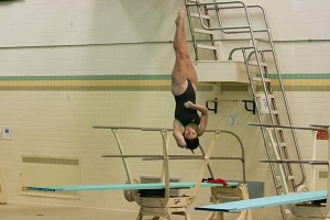 Junior Sophia Garris competes in the 1 meter springboard diving competition during a recent home meet. (NW File Photo)