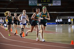 Sophomore Melaina Mrozek (left) finished second in pole vault at Northern Michigan University's 2013 indoor meet. At the 2014 UW-Stout Open, sophomore Catherine Swiderski (right) finished third in the 3,000-meter run. (NW File Photo)