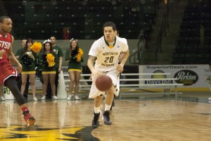 Senior forward Michael Smith (12) had four points in the 74-66 NMU victory over Wayne State. Junior forward Chavis Mattison (23) had 17 points off the bench and junior guard Ethan Blackwell finished with eight points. (Anthony Viola NW)