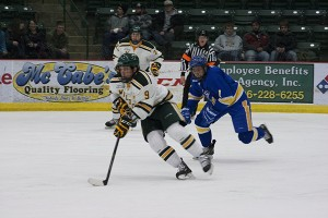 (Anthony Viola/NW) Juniors Reed Seckel (9) at forward and Jake Baker (23) at defense, are leaders on the ice.