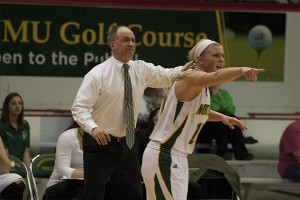 (Anthony Viola/NW) Junior guard Lauren Gruber (10) gets into the game alongside head coach Troy Mattson. The Wildcats (13-6) finished with a one-point victory over GLIAC visitor Saginaw Valley State University (10-8) Thursday, Feb. 13.