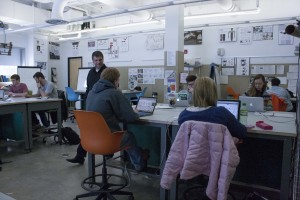 (Anthony Viola/NW) Associate Professor Peter Pless works with students in the human centered design lab located in the Art and Design building at NMU.