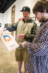 """Senior graphic communication majors Jim Debrock, left, and Christopher LaRose, right, work together to recreate parts of the '90s Nickelodeon show, """"Adventures of Pete and Pete,"""" with posters of events from the show. (Analicia Honkanen/NW)"""